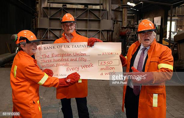 Boris Johnson MP Gisela Stuart MP and Douglas Carswell throw a cheque into furnace during a tour of the JBMI Group Kingsilver Refinery in Hixon...
