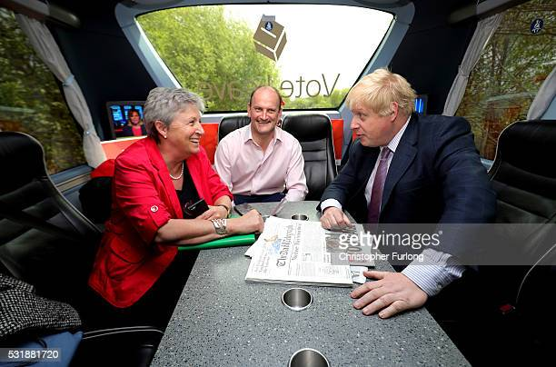 Boris Johnson MP Labour MP Gisela Stuart and UKIP MP Douglas Carswell have a meeting on board the Vote Leave Brexit Battle Bus on May 17 20016 in...