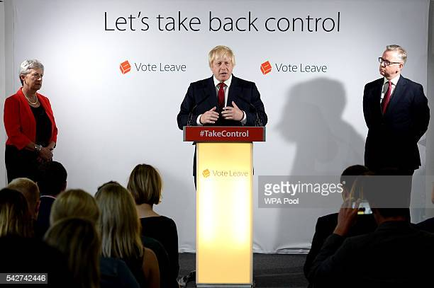 Boris Johnson MP speaks during a press conference as Gisela Stuart and Michael Gove look on following the results of the EU referendum at Westminster...
