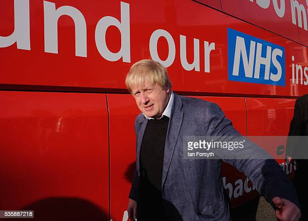 Boris Johnson MP walks past the battle bus during a visit ChesterLeStreet Cricket Club as part of the Brexit tour on May 30 2016 in ChesterLeStreet...