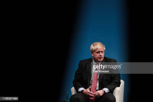 Boris Johnson onstage during the Conservative leadership hustings at Cheltenham Racecourse on July 12, 2019 in Cheltenham, England. Boris Johnson and...