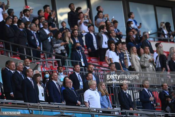 Boris Johnson, Prime Minister of England, and his wife, Carrie Johnson are seen in the stands prior to the UEFA Euro 2020 Championship Semi-final...