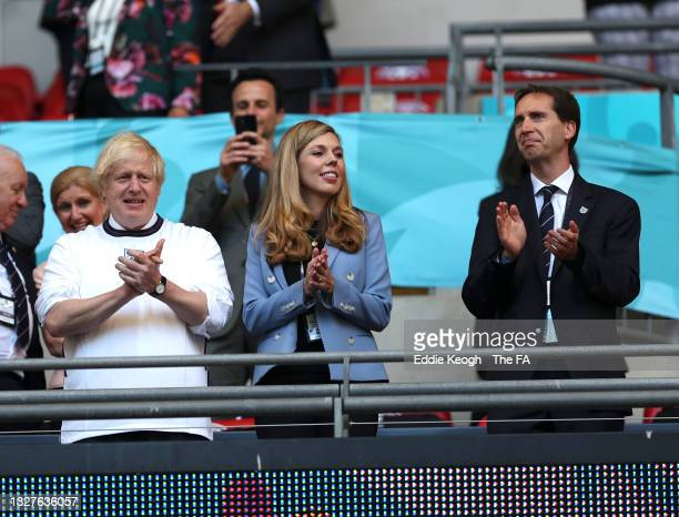 Boris Johnson, Prime Minister of England, and his wife, Carrie Johnson, are seen alongside Mark Bullingham, CEO of the Football Association prior to...