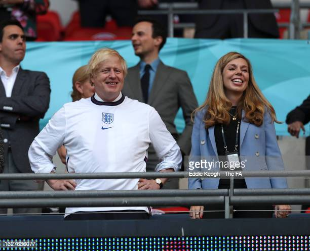 Boris Johnson, Prime Minister of England, and his wife, Carrie Johnson, are seen prior to the UEFA Euro 2020 Championship Semi-final match between...