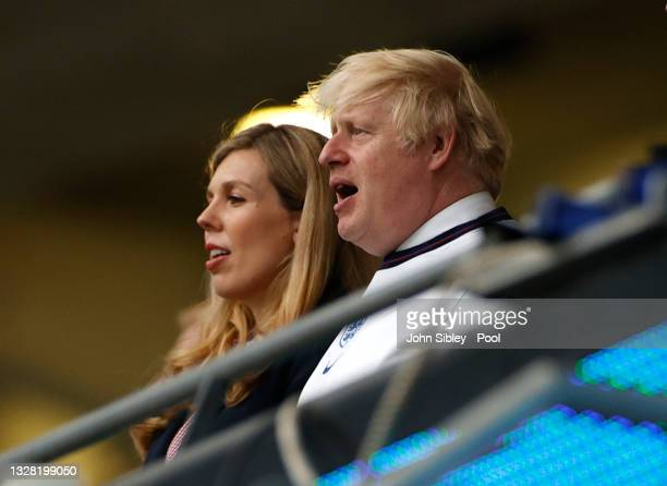 Boris Johnson, Prime Minister of England, and his wife, Carrie Johnson sing the national anthem prior to the UEFA Euro 2020 Championship Final...