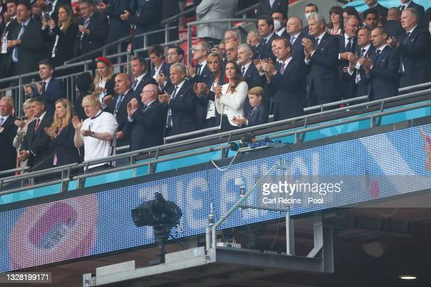 Boris Johnson, Prime Minister of England and his wife, Carrie Johnson applaud next to Prince William, President of the Football Association,...