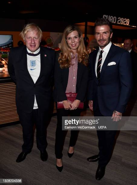 Boris Johnson, Prime Minister of England, his wife, Carrie Johnson and Former England International, David Beckham pose for a photograph prior to the...