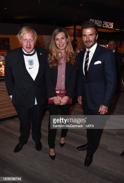 Boris Johnson, Prime Minister of England, his wife, Carrie Johnson, and Former England player David Beckham pose for a photograph prior to the UEFA...