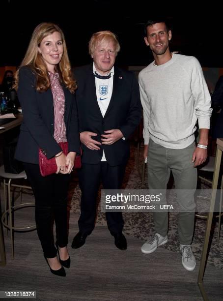 Boris Johnson, Prime Minister of England, his wife, Carrie Johnson and Tennis Player and Wimbledon 2021 Men's Singles Champion, Novak Djokovic pose...