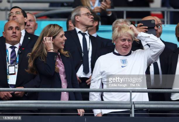 Boris Johnson, Prime Minister of the United Kingdom, and his wife, Carrie Johnson look on during the UEFA Euro 2020 Championship Final between Italy...