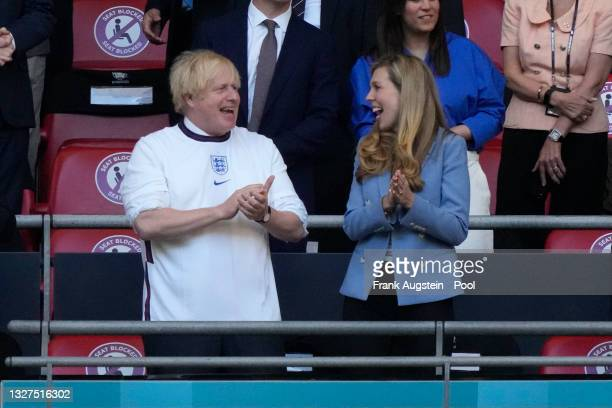 Boris Johnson, Prime Minister of United Kingdom and his wife, Carrie Johnson react prior to the UEFA Euro 2020 Championship Semi-final match between...