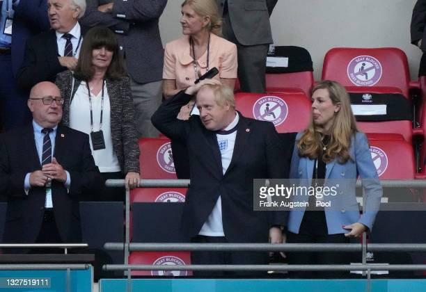 Boris Johnson, Prime Minister of United Kingdom and his wife, Carrie Johnson look on prior to the UEFA Euro 2020 Championship Semi-final match...