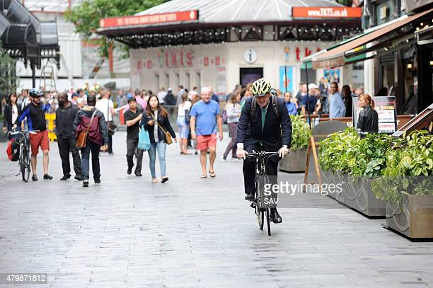 Boris Johnson rides his bicycle outside Global House on July 8 2015 in London England