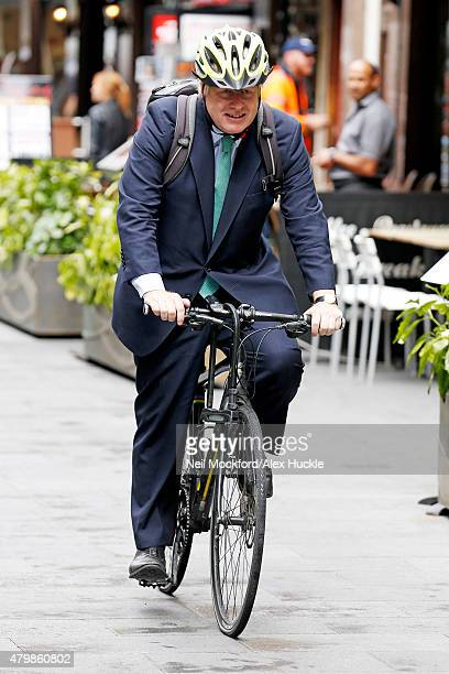 Boris Johnson seen cycling through Leicester Square after an appearance on LBC Radio on July 8 2015 in London England