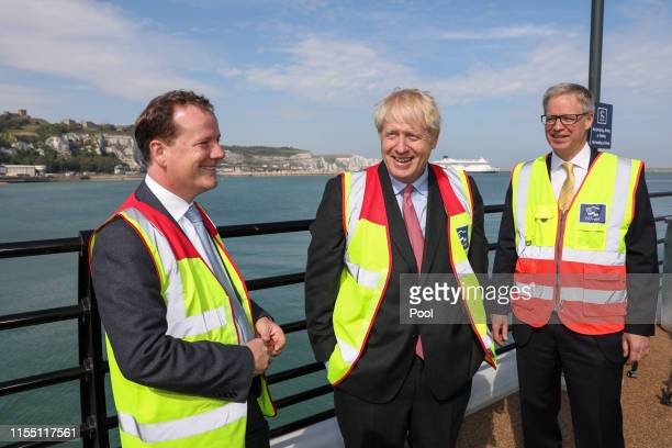 Boris Johnson talks with Charlie Elphicke UK lawmaker and Doug Bannister chief executive officer of Port of Dover Ltd during a visit to the Port of...