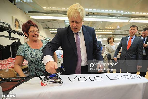 Boris Johnson the former Mayor of London irons a Vote Leave flag which was made during a visit to David Nieper Ltd on May 16 2016 in Alfreton England...