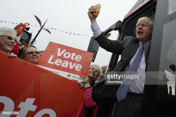 Boris Johnson the former mayor of London waves a Cornish Pasty during the first day of a nationwide bus tour to campaign for a socalled Brexit in...