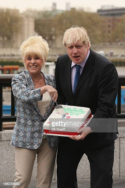 Boris Johnson the Mayor of London and actress Barbara Windsor promote 'The Big Lunch' outside City Hall on May 7 2013 in London England The...