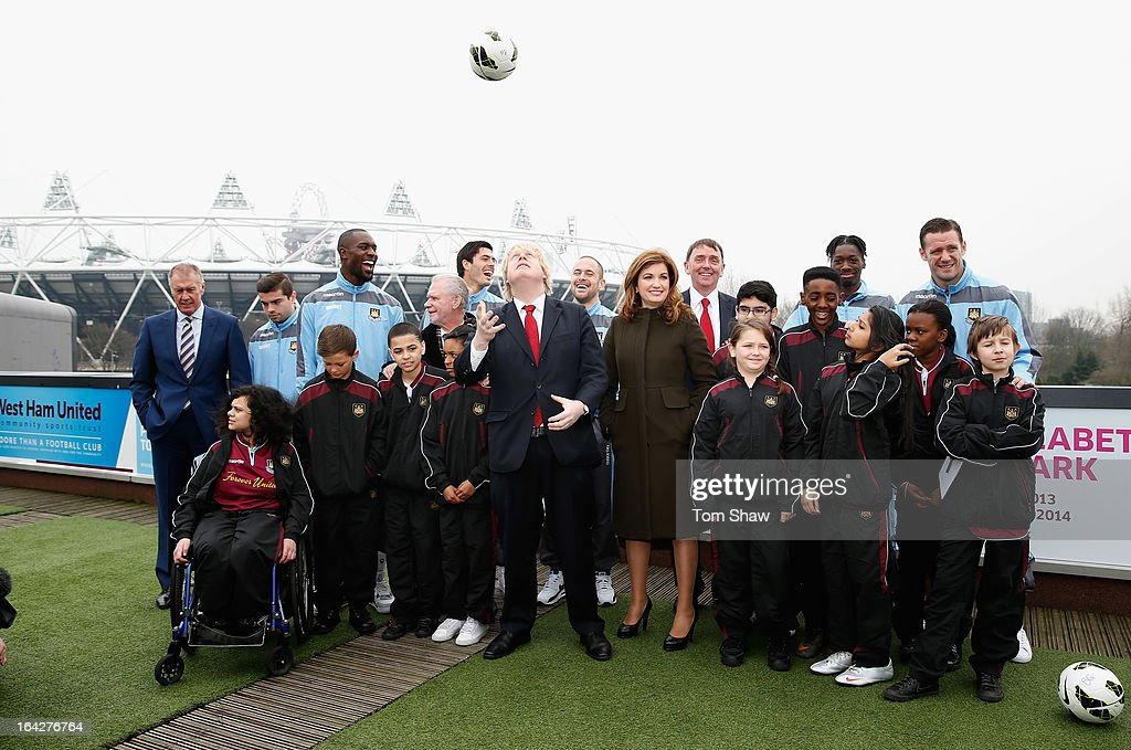 Boris Johnson the Mayor of London and players from West Ham pose for a picture during the press conference to announce the future of the Olympic Stadium on March 22, 2013 in London, England. West Ham have been announced as the main tenants of the Olympic Stadium and will pay 15 million GBP upfront towards conversion costs and an annual rent of 2 million GBP.