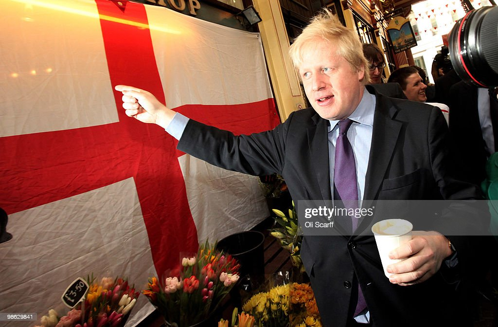 Boris Johnson, the Mayor of London, points at a St Georges' Cross as he tours Leadenhall Market on St George's Day on April 23, 2010 in London, England. Addressing a crowd in the market Mr Cameron said he wanted to reclaim the English flag from the British National Party who are due to launch their election manifesto today.