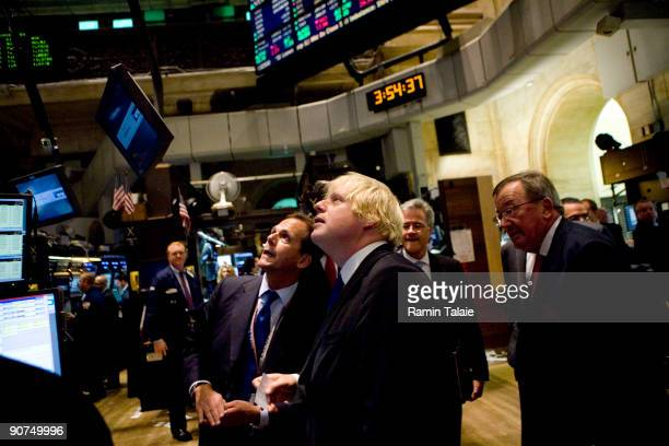 Boris Johnson the mayor of London, speaks with Robert Hardy , a trader on the floor of the New York Stock Exchange prior to ringing the closing bell...