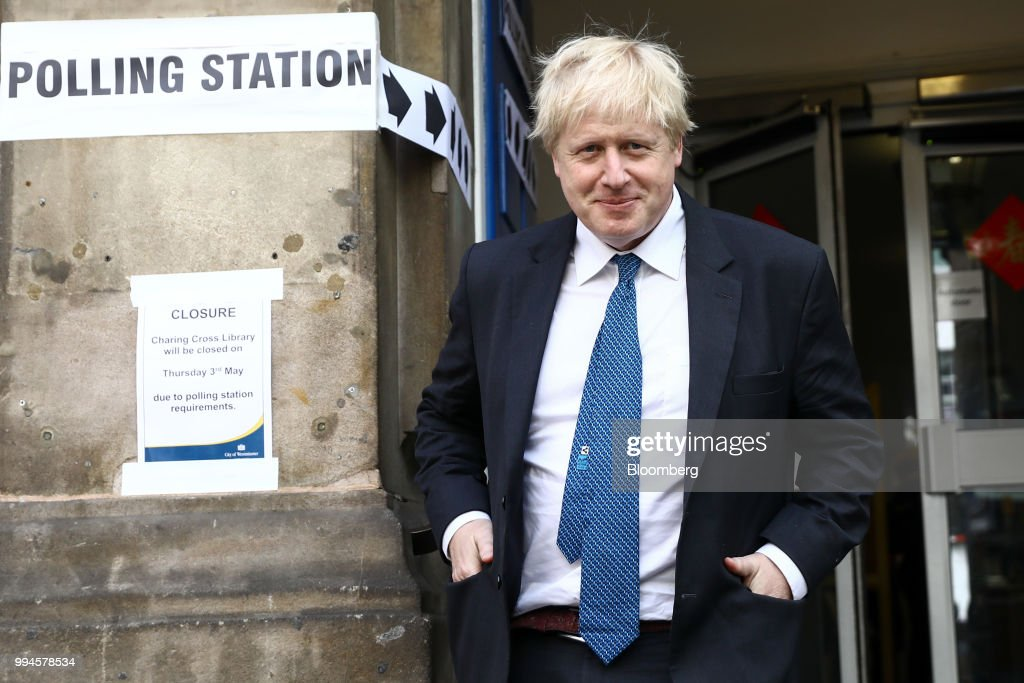 Boris Johnson, U.K. foreign secretary, leaves a polling station after voting in local elections in London, U.K., on Thursday, May 3, 2018.Johnson resigned from the U.K. government, tipping Prime Minister Theresa May deeper into crisis and increasing the chances shell face a leadership challenge over her Brexit policy. Hours earlier Brexit Secretary David Davis and his deputy resigned over her plans to keep close ties to the European Union after the divorce. The man who is going to inherit one of the toughest jobs in the U.K. -- negotiating Brexit -- is a 44-year-old former Foreign Office lawyer who entered Parliament in 2010: Dominic Raab. Our editors select the best archive images of Raab, Davis and Johnson. Photographer: Simon Dawson/Bloomberg via Getty Images