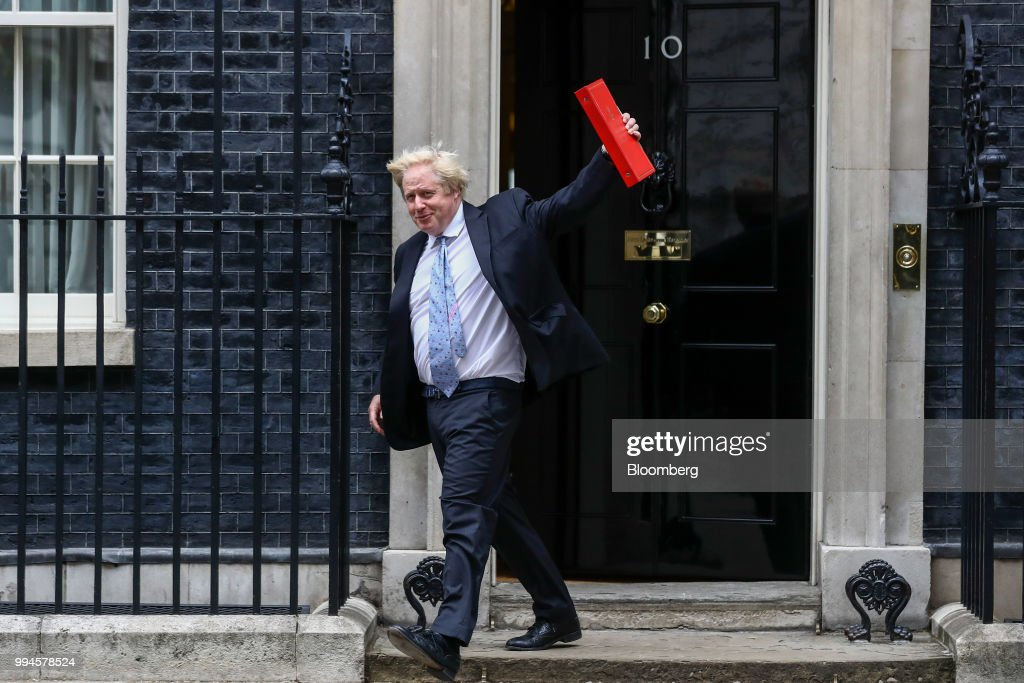 Boris Johnson, U.K. foreign secretary, leaves after attending a meeting of cabinet minsters at number 10 Downing Street in London, U.K., on Tuesday, June 5, 2018. Johnson resigned from the U.K. government, tipping Prime Minister Theresa May deeper into crisis and increasing the chances shell face a leadership challenge over her Brexit policy. Hours earlier Brexit Secretary David Davis and his deputy resigned over her plans to keep close ties to the European Union after the divorce. The man who is going to inherit one of the toughest jobs in the U.K. -- negotiating Brexit -- is a 44-year-old former Foreign Office lawyer who entered Parliament in 2010: Dominic Raab. Our editors select the best archive images of Raab, Davis and Johnson. Photographer: Simon Dawson/Bloomberg via Getty Images