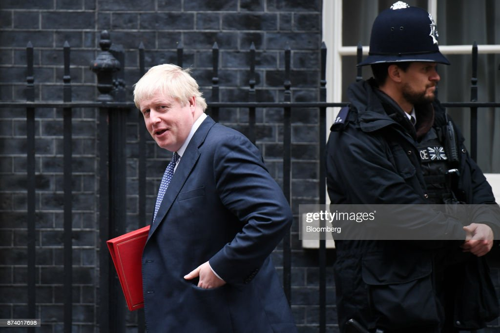 Boris Johnson, U.K. foreign secretary, leaves following a cabinet meeting at number 10 Downing Street in London, U.K., on Tuesday, Nov. 14, 2017. Analysts are more optimistic than the U.K. government that an agreement will be reached with the European Union next month to move Brexit talks on to trade even as Theresa Mays political troubles continue to weigh on the countrys beleaguered currency. Photographer: Chris J. Ratcliffe/Bloomberg via Getty Images