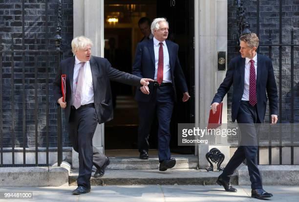 Boris Johnson UK foreign secretary left David Davis UK exiting the European Union secretary centre and Gavin Williamson UK defence secretary leave...