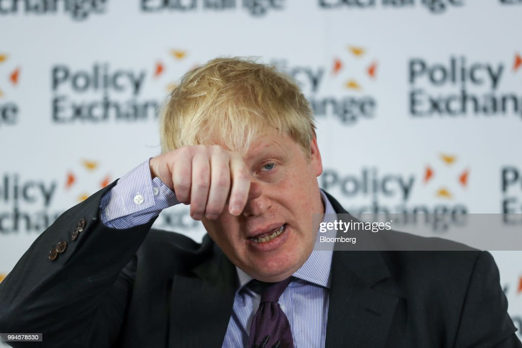 Boris Johnson, U.K. foreign secretary, wipes his forehead as he delivers a speech in London, U.K., on Wednesday, Feb. 14, 2018. Johnson resigned from the U.K. government, tipping Prime Minister Theresa May deeper into crisis and increasing the chances shell face a leadership challenge over her Brexit policy. Hours earlier Brexit Secretary David Davis and his deputy resigned over her plans to keep close ties to the European Union after the divorce. The man who is going to inherit one of the toughest jobs in the U.K. -- negotiating Brexit -- is a 44-year-old former Foreign Office lawyer who entered Parliament in 2010: Dominic Raab. Our editors select the best archive images of Raab, Davis and Johnson. Photographer: Simon Dawson/Bloomberg via Getty Images