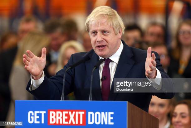 Boris Johnson, U.K. Prime minister and leader of the Conservative Party, gestures as he speaks during a general election campaign visit to the JCB...