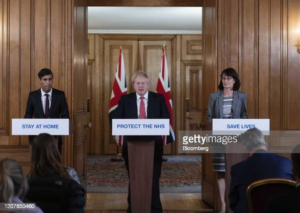 Boris Johnson UK prime minister center speaks while Rishi Sunak UK chancellor of the exchequer left and Jenny Harries deputy chief medical officer...