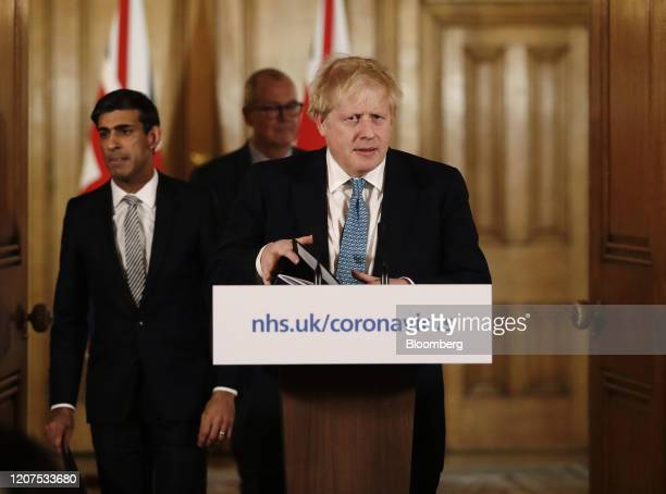 Boris Johnson UK prime minister front right Rishi Sunak UK chancellor of the exchequer left and Patrick Vallance UK lead science adviser arrive for a...