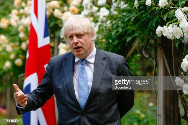 Boris Johnson, U.K. Prime minister, gestures during a joint news conference with Scott Morrison, Australia's prime minister, during their bilateral...
