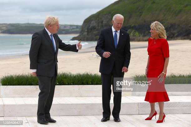 Boris Johnson, U.K. Prime minister, gestures to U.S. President Joe Biden, center, and U.S. First Lady Jill Biden, as they arrive for the 'family...