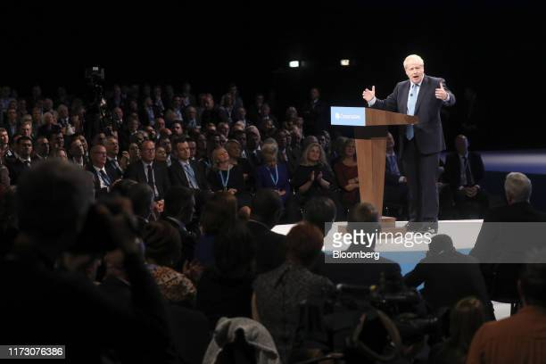 Boris Johnson, U.K. Prime minister, gestures while delivering his keynote speech on the closing day of the annual Conservative Party conference at...