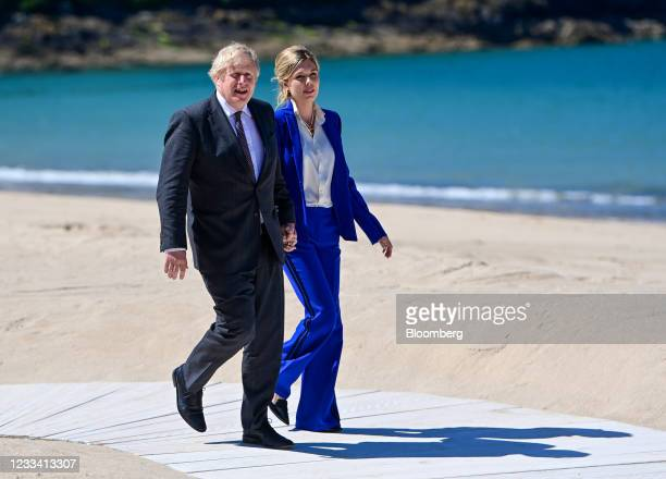 Boris Johnson, U.K. Prime minister, left, and Carrie Johnson, his wife, arrive on day two of the Group of Seven leaders summit in Carbis Bay, U.K.,...