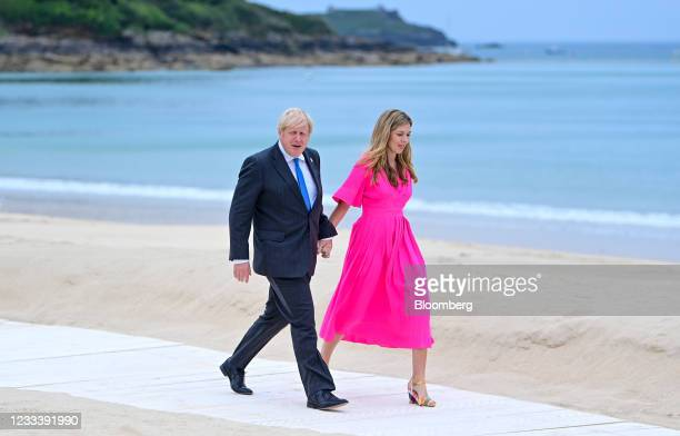 Boris Johnson, U.K. Prime minister, left, and Carrie Johnson, wife of U.K. Prime Minister Boris Johnson, arrive on the first day of the Group of...
