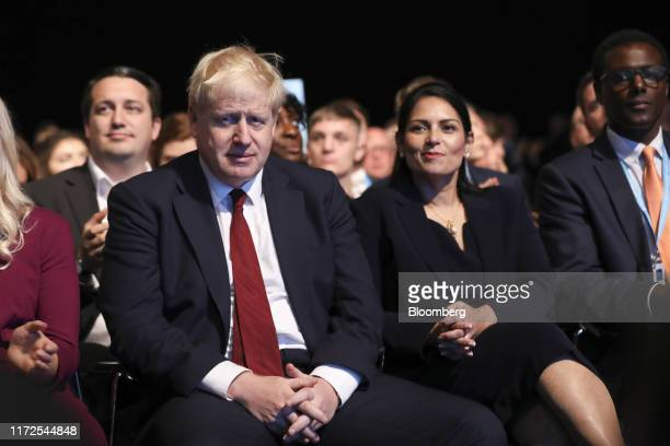 Boris Johnson UK prime minister left and Priti Patel UK home secretary right attend day two of the annual Conservative Party conference at Manchester...