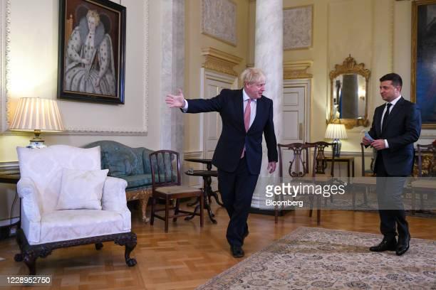Boris Johnson, U.K. Prime minister, left, gestures to Volodymyr Zelenskiy, Ukraine's president, at the start of their bilateral meeting in The...