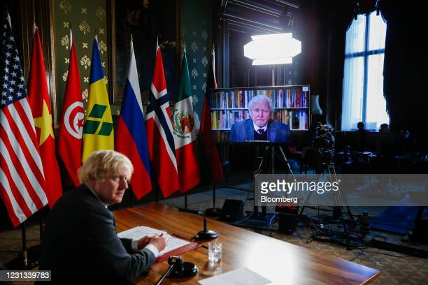 Boris Johnson, U.K. Prime minister, left, listens to a video link from David Attenborough, broadcaster and natural historian, as he hosts the UN...