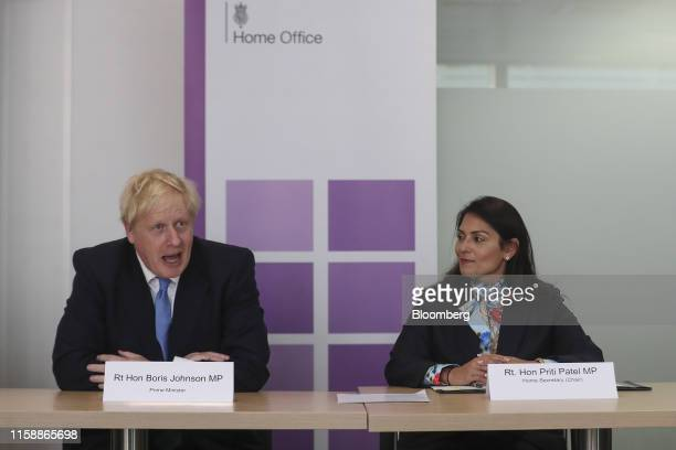 Boris Johnson UK prime minister left speaks as Priti Patel UK home secretary listens during the National Policing Board meeting in London UK on...