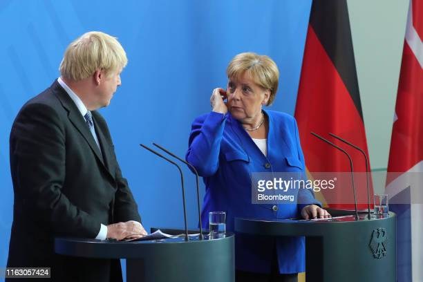 Boris Johnson UK prime minister left speaks beside Angela Merkel Germany's chancellor during a news conference at the Chancellery in Berlin Germany...