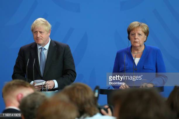 Boris Johnson UK prime minister left stands beside Angela Merkel Germany's chancellor during a news conference at the Chancellery in Berlin Germany...
