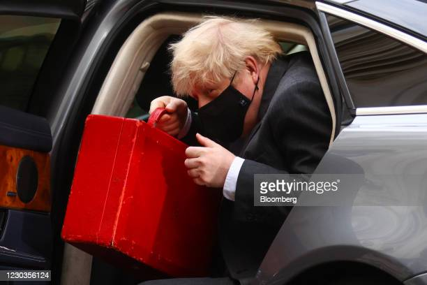 Boris Johnson, U.K. Prime minister, returns to number 10 Downing Street after attending Parliament in London, U.K., on Wednesday, Dec. 30, 2020....