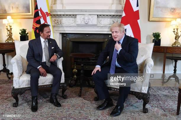 Boris Johnson UK prime minister right and Hassanal Bolkiah Brunei's sultan speak during their meeting inside number 10 Downing Street in London UK on...