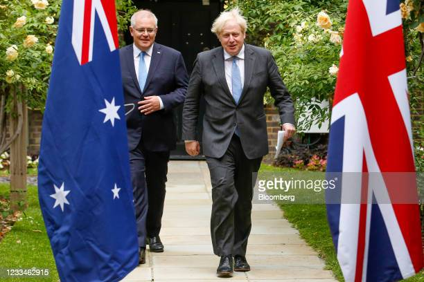 Boris Johnson, U.K. Prime minister, right, and Scott Morrison, Australia's prime minister, arrive to give a joint news conference during their...