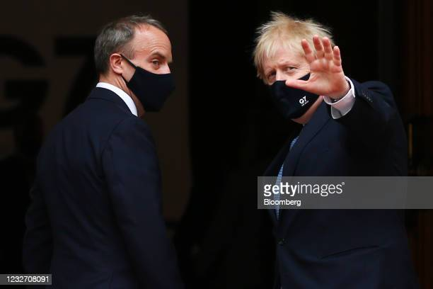 Boris Johnson, U.K. Prime minister, right, gestures as he arrives with Dominic Raab, U.K. Foreign secretary, on day two of the G-7 foreign and...