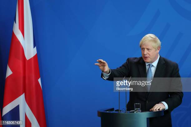 Boris Johnson UK prime minister speaks beside Angela Merkel Germany's chancellor not pictured during a news conference at the Chancellery in Berlin...