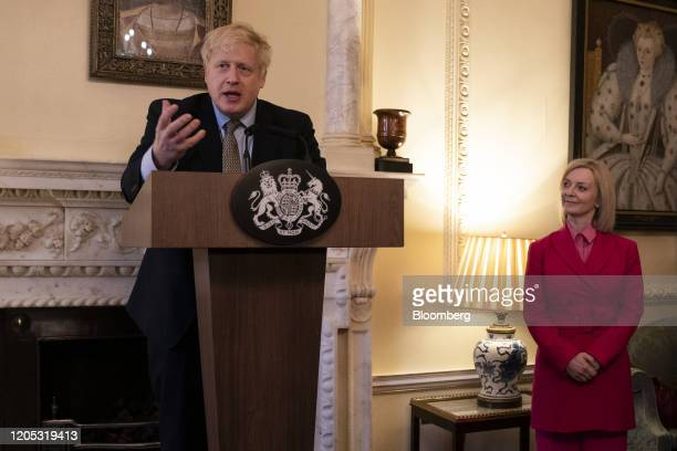 Boris Johnson UK prime minister speaks during an event while flanked by Liz Truss UK international trade secretary to mark International Women's Day...